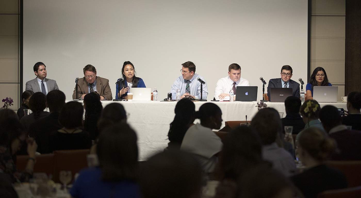 A panel of students and faculty discuss election results during an event at the Athenaeum in 2018.