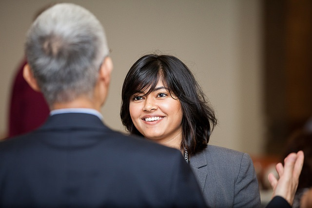 Student engaging with a professional at a networking event.