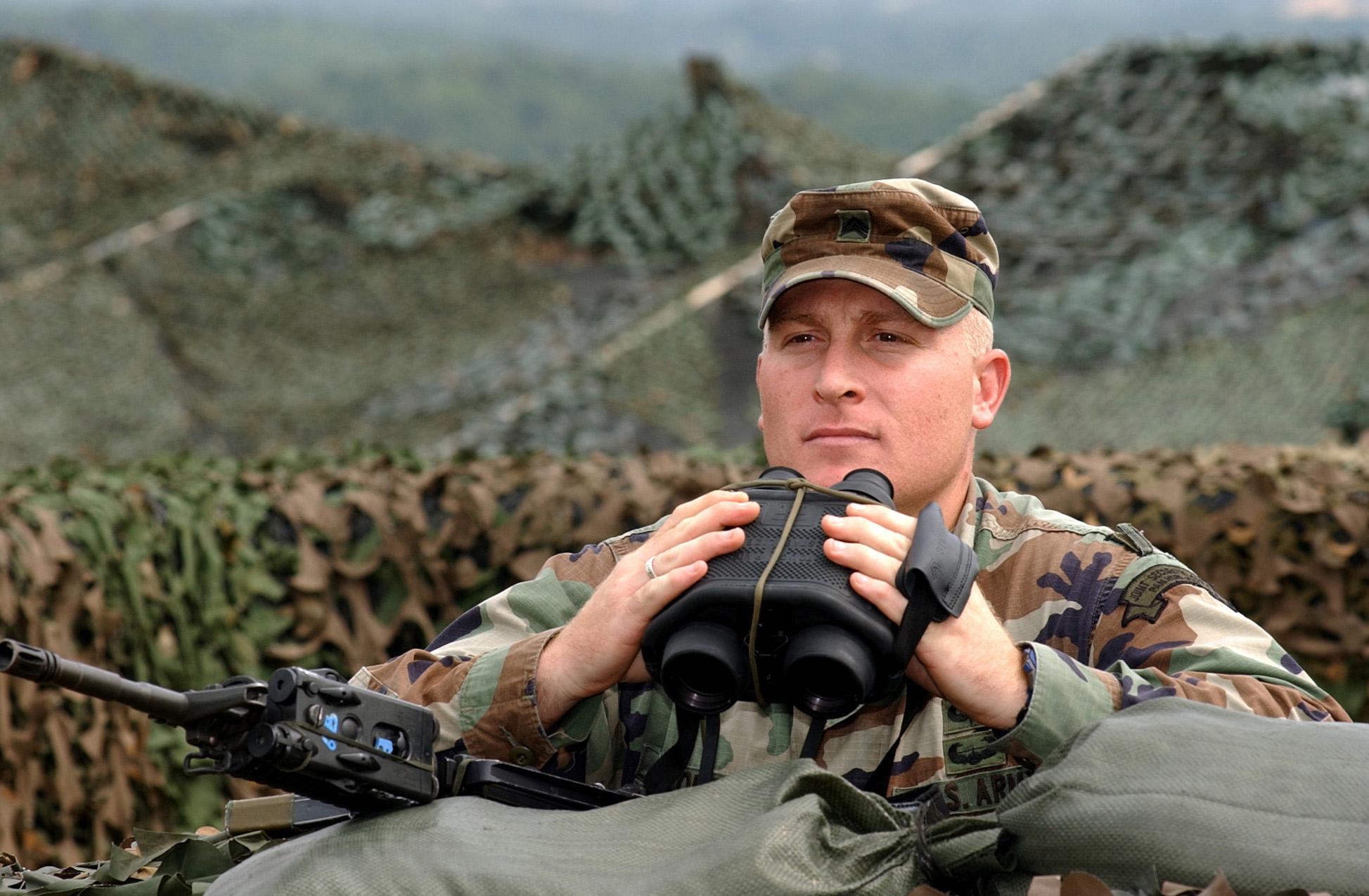 Soldier holding binoculars near the N-S Korean border