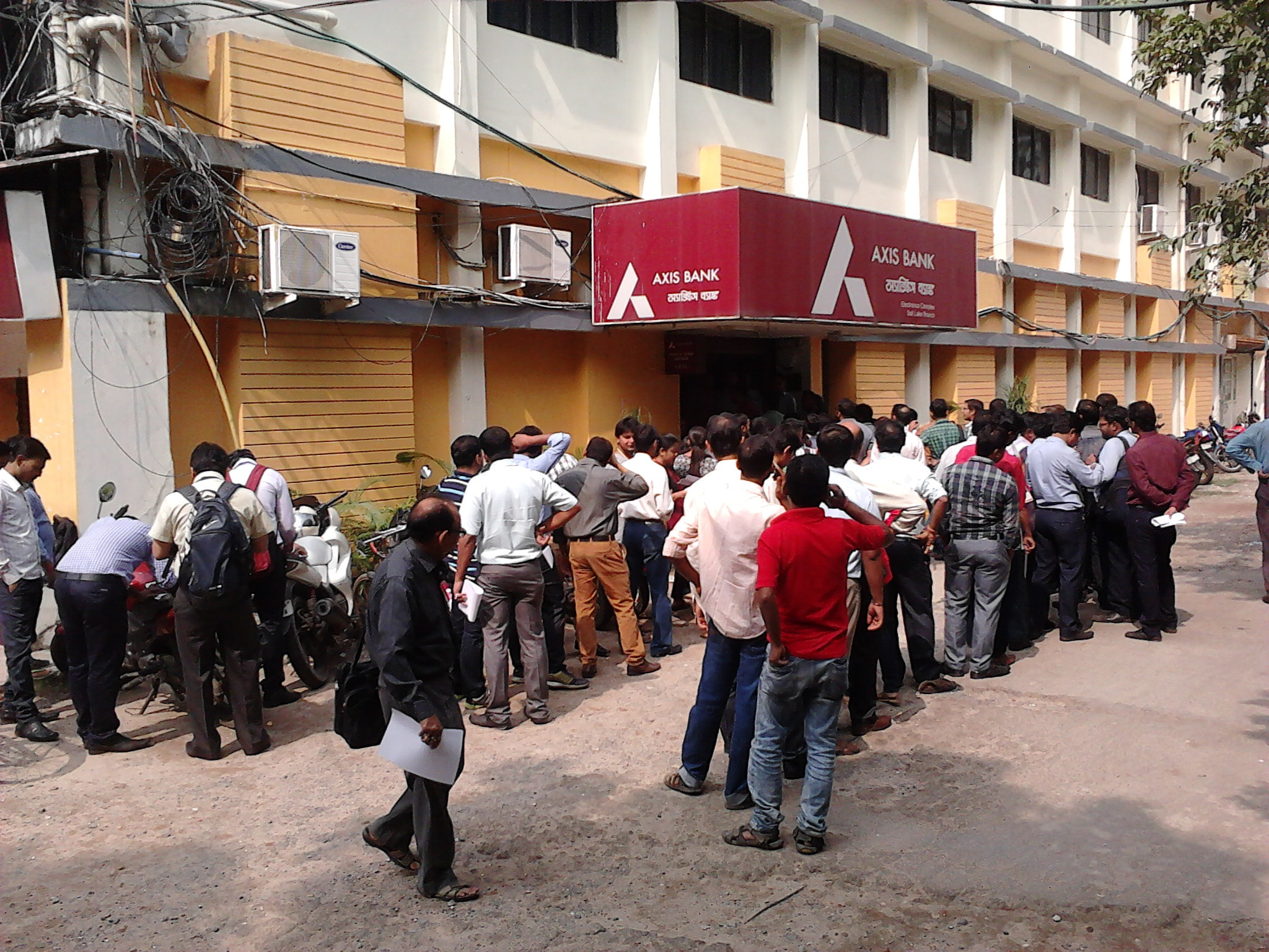 People queueing outside a private bank in Kolkata