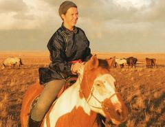 Katherine Krey riding on a pony