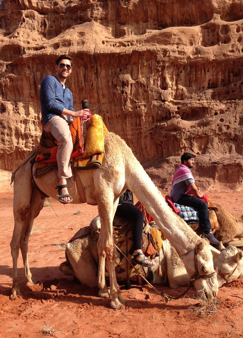 Tim Plummer riding on a camel