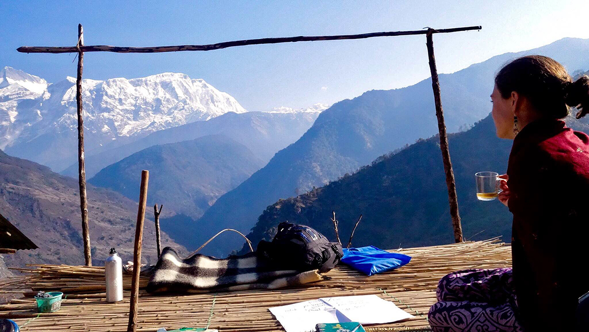 A CMC study abroad student enjoys a view of the mountains while studying