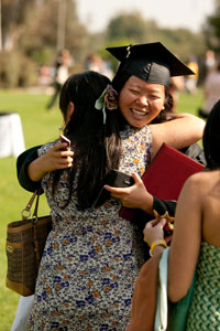 recent graduate embracing her mother