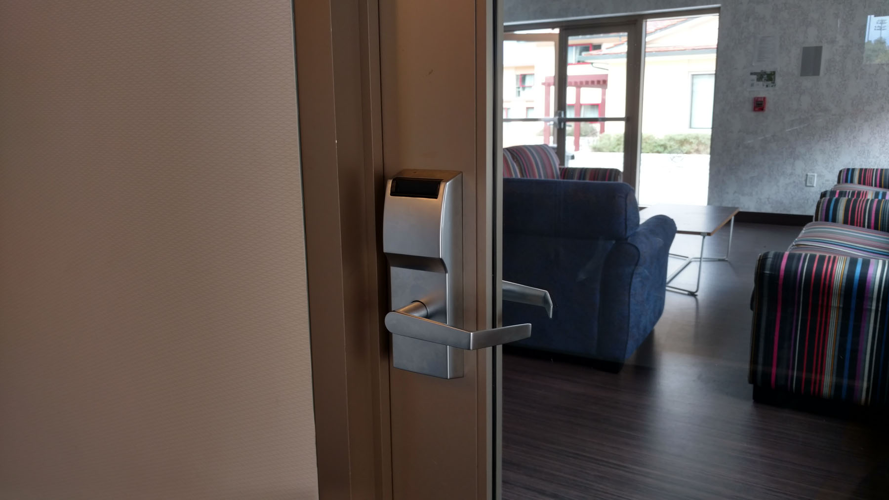 Electronic door lock to common room area