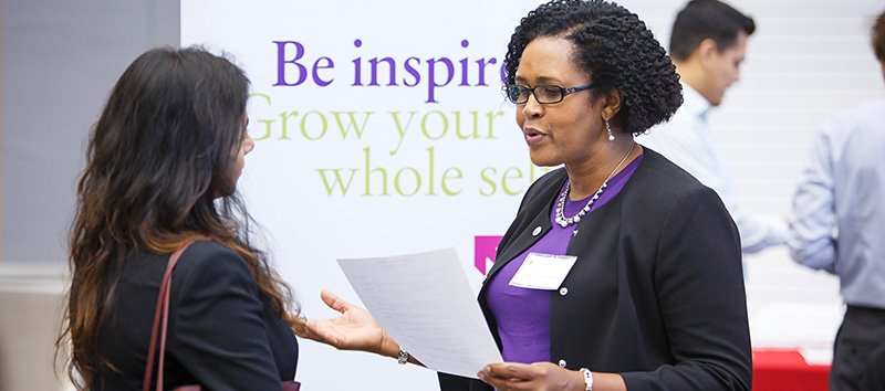 Student talking to a recruiter at a Career Center event