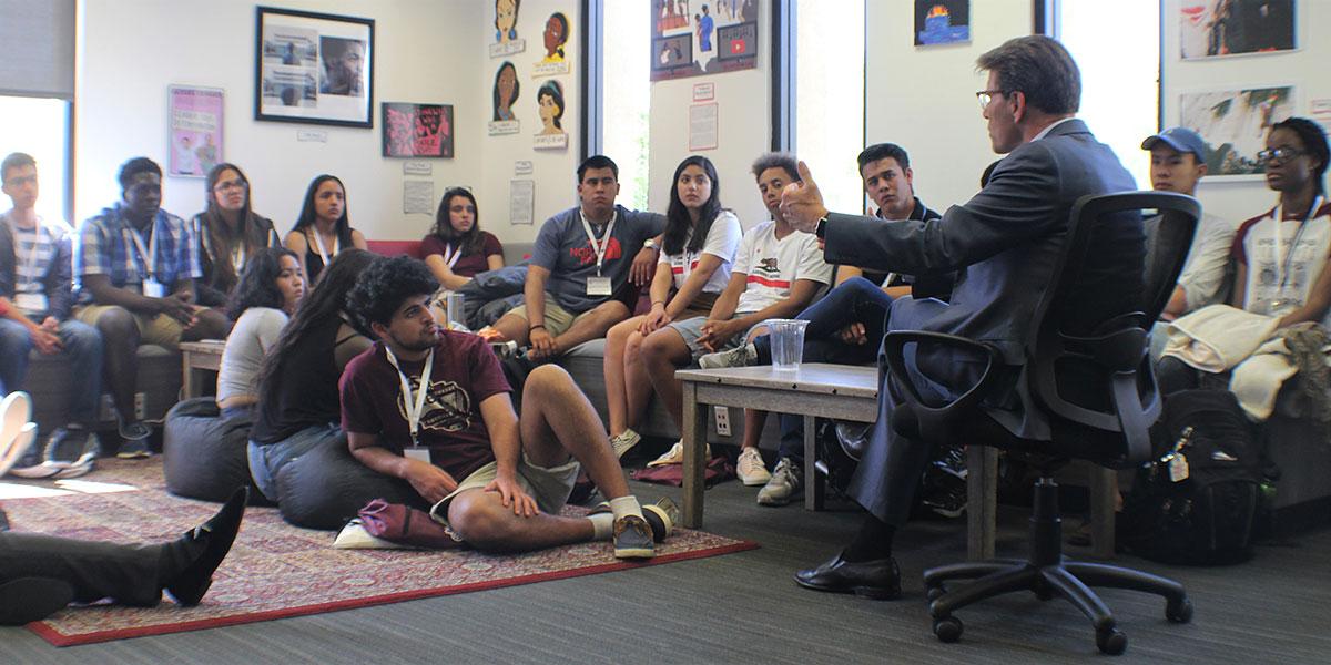 Hiram Chodosh talks with students