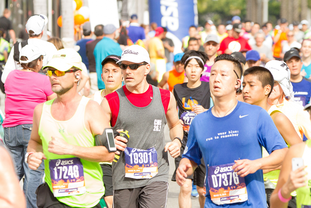 CMC President Hiram Chodosh (center) during this year's LA Marathon