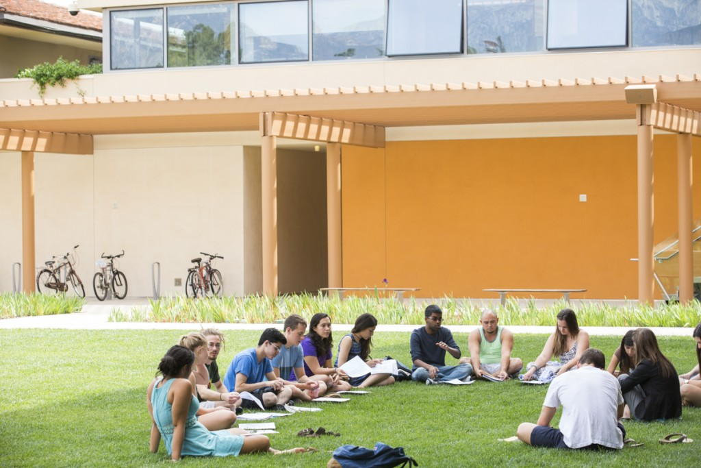 Students meeting on the Gann Quadrangle in front of the Kravis Center.