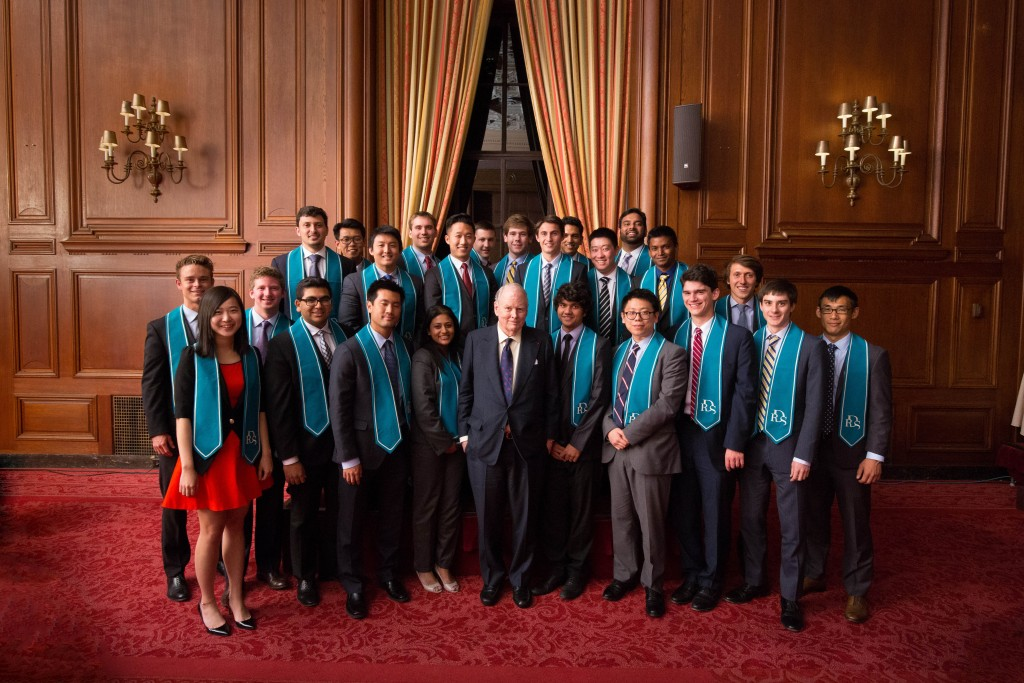 Robert Day Scholars from the Master's Program in Finance Class of 2015 pose with Robert Day.