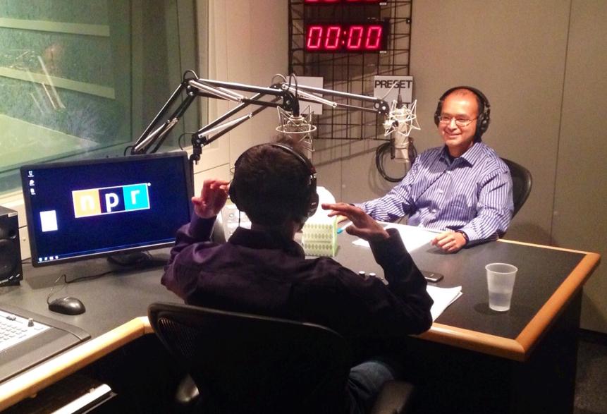 Ananda Ganguly with CGU professor Joshua Tasoff (back turned) in the NPR West studio