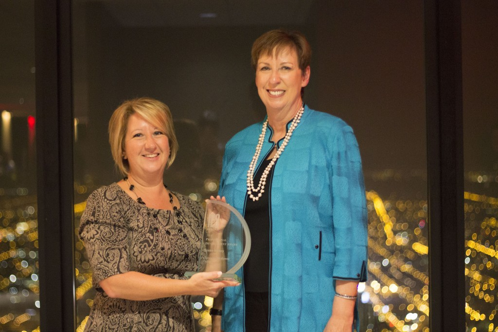 CMC Director of Off-Campus Studies Kristen Mallory (left) receives the Professional Development Award from Dr. Mary Dwyer, President and CEO of IES Abroad.