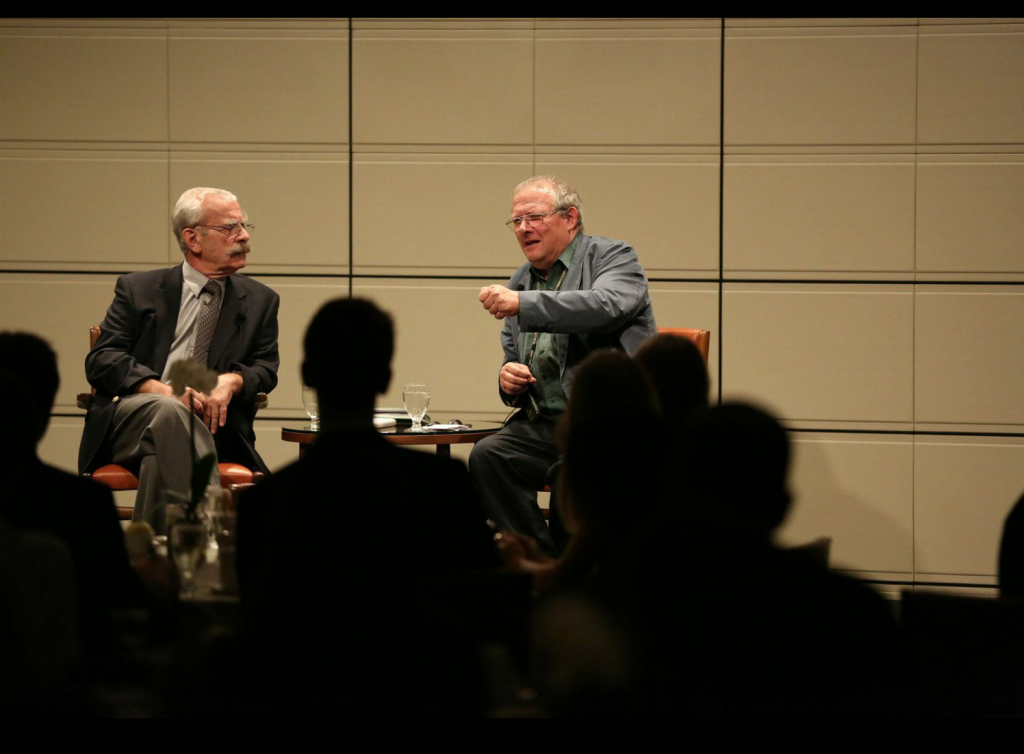 EUROPEAN CHALLENGES: Adam Michnik (right) discusses the political climate in Eastern Europe with a large Athenaeum audience  (pictured on left: translator Josef Sobelman).  Photo credit/William Vasta