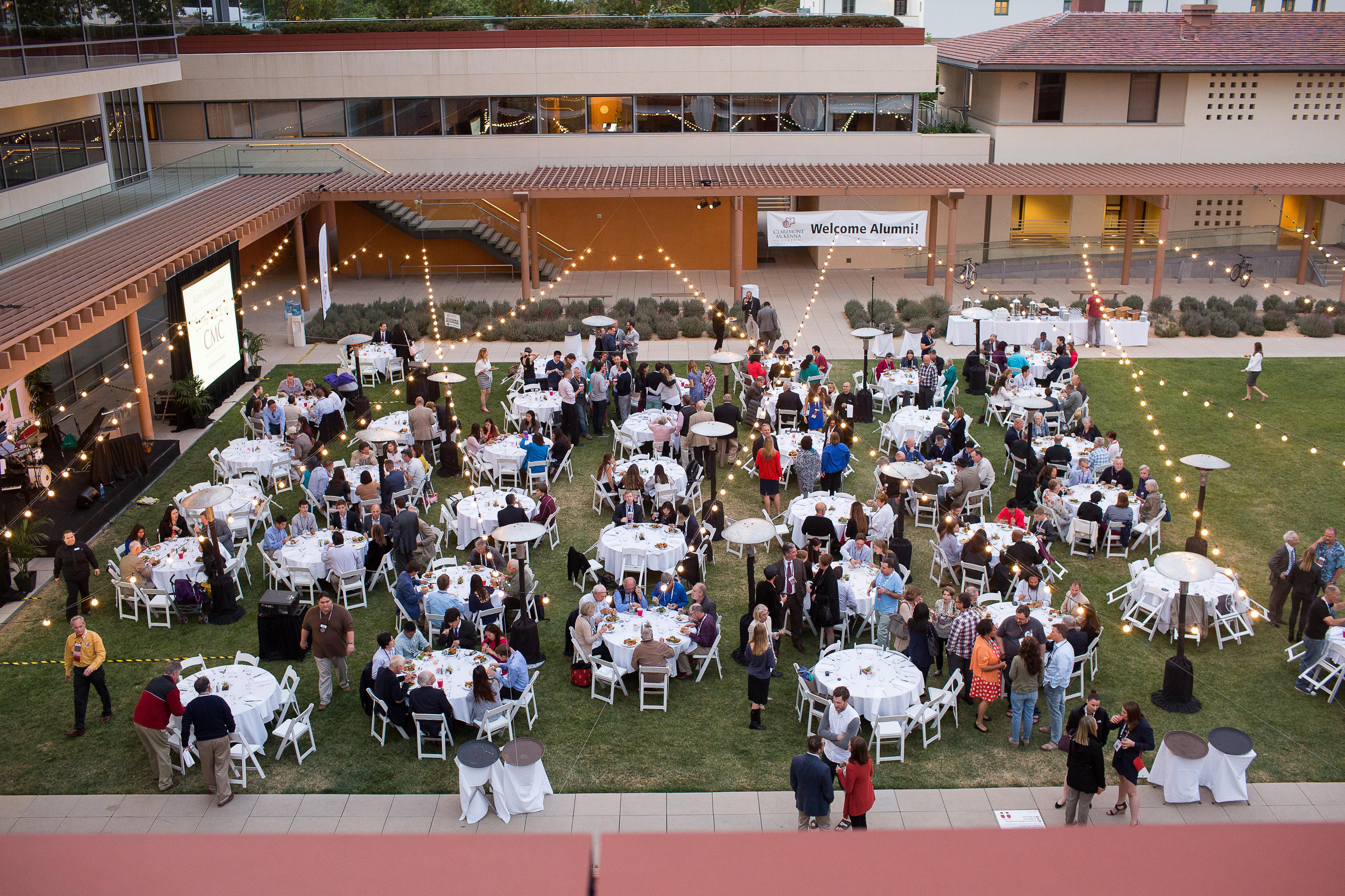 Alumni gather near the Kravis Center for an alumni weekend reception.