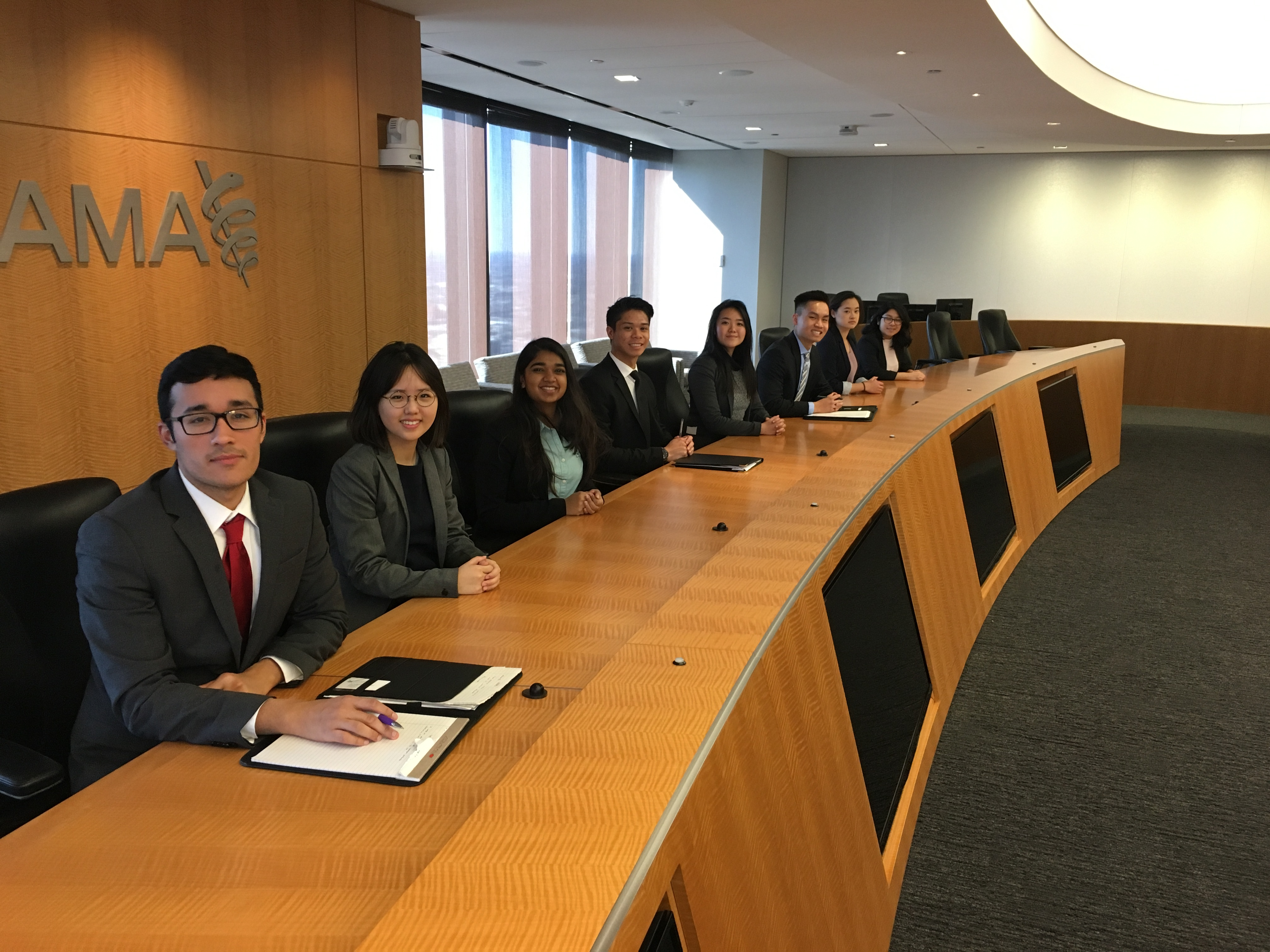 CMC students in the board room of a company in Chicago during their trip