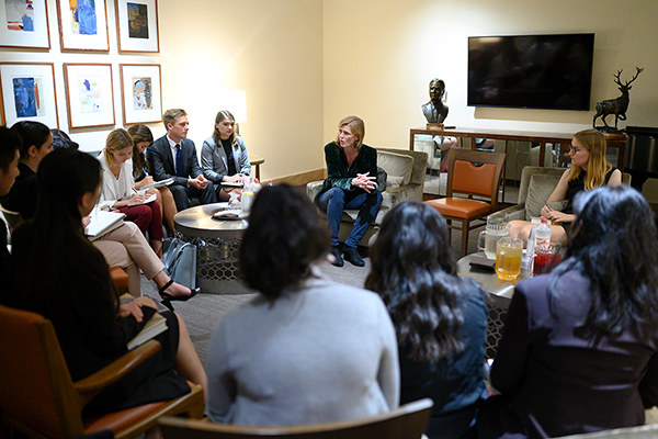 Samantha Powers chats with a group of CMC students
