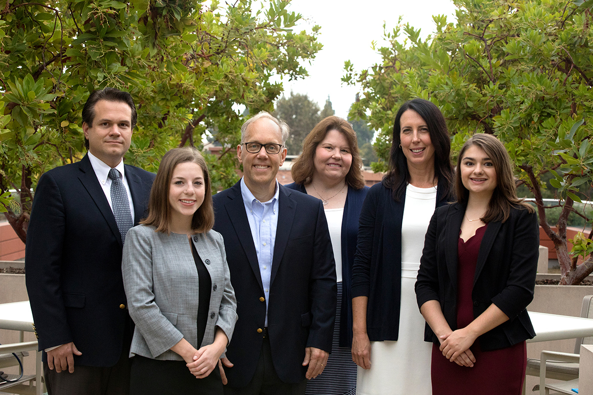 Professors Zach Courser '99 and Eric Hellan stand with their Policy Lab research team