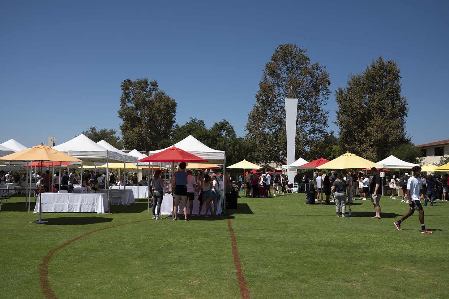 Information booths line Parents Field for CMC's Club and Institute Fair.