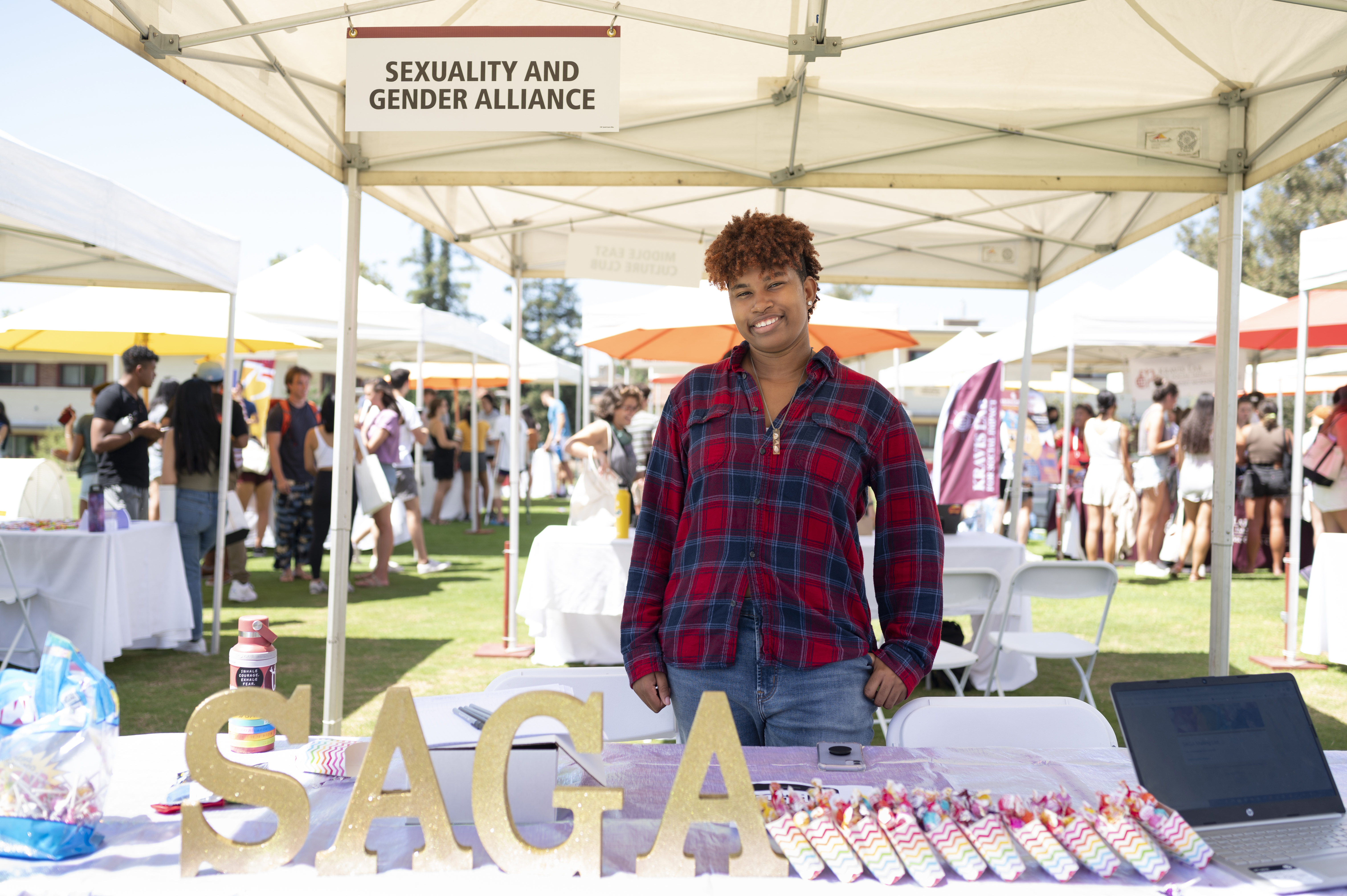 Jenasis Yarrell '24 shares information at the Sexuality and Gender Alliance booth.