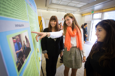 Students studying a research poster