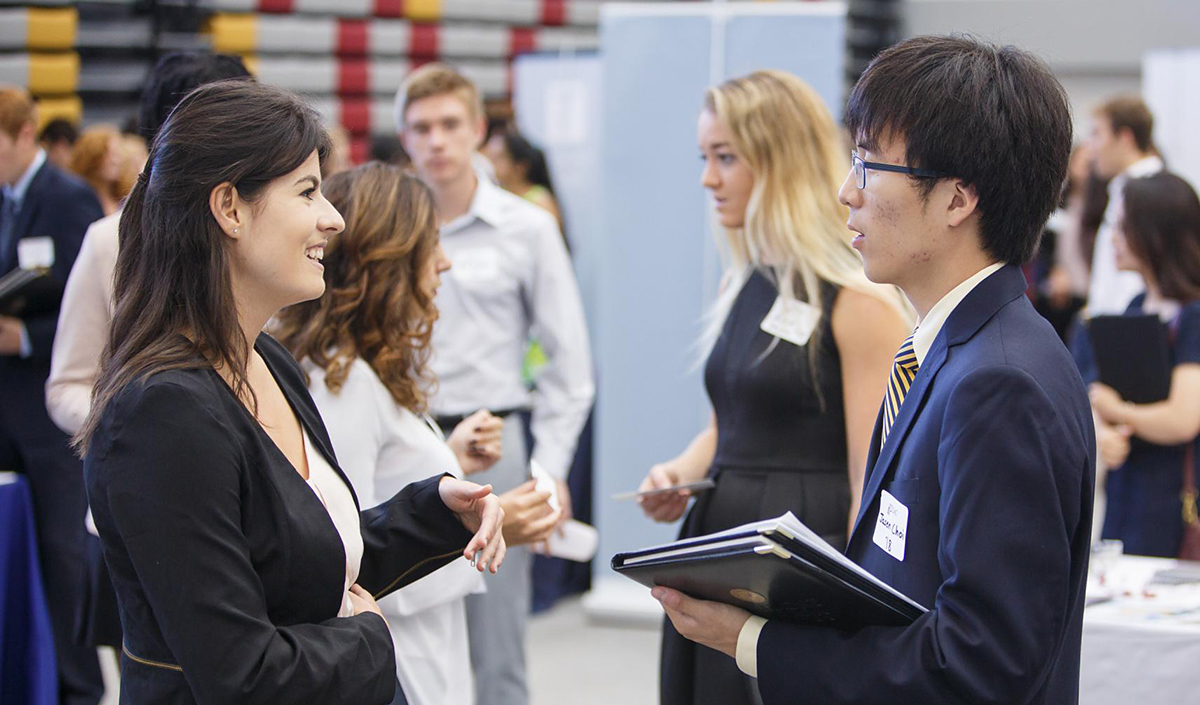 People talking at a career fair