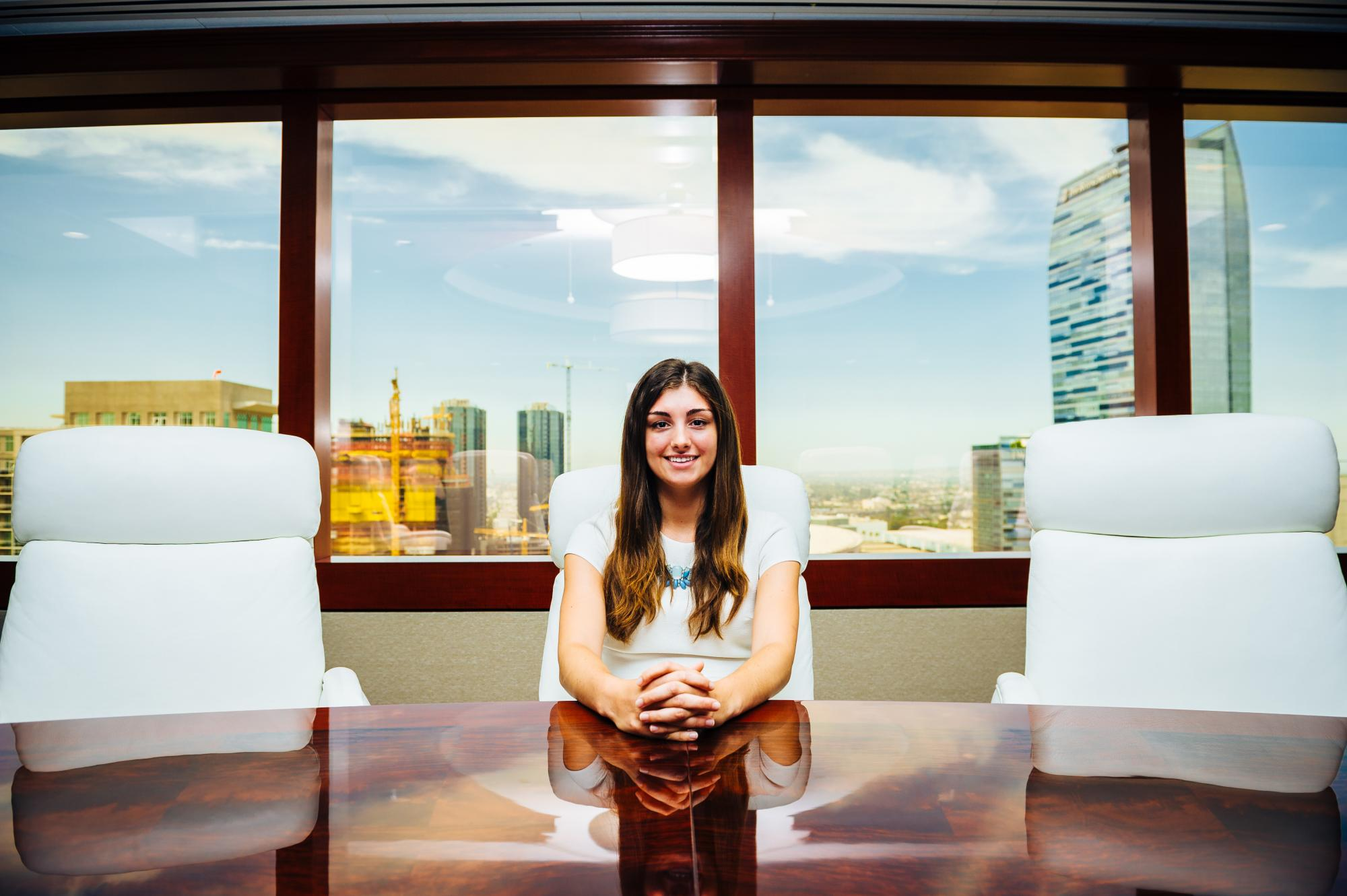Picture of young woman at a boardroom table
