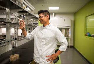 Pete Chandrangsu, assistant professor of biology, in a lab (Courtesy of Scripps College)