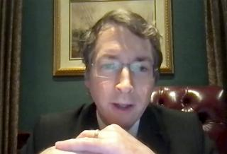 Screen capture of Richard Lowry, editor of National Review and a conservative pundit, speaking at virtual Ath.