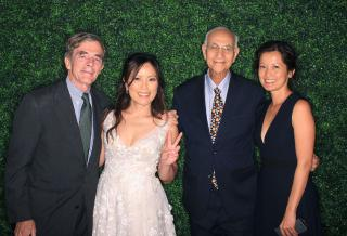 CMC Prof. Marc Massoud (pictured second from right) celebrating with Stella Ho '97 at her wedding, along with CMC Prof. James Taylor and alumna Julie Chen Woo '97.