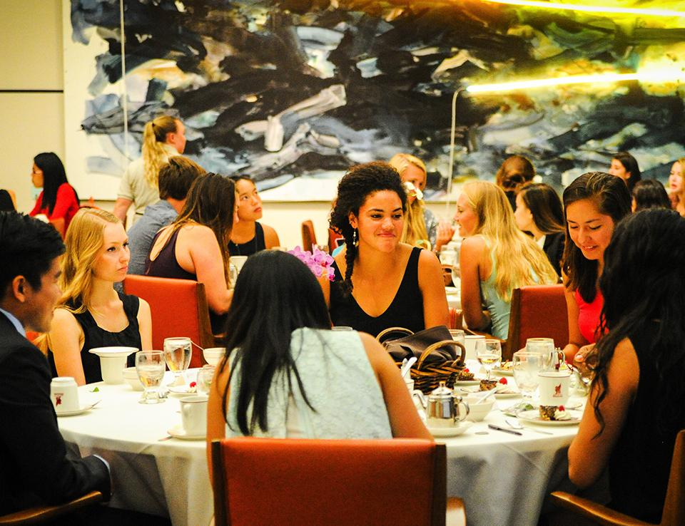 Students talking at table