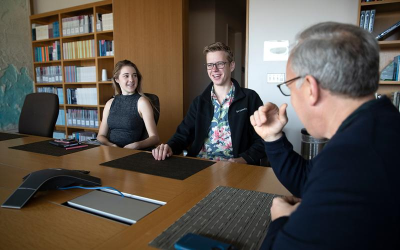 Professor meets with students