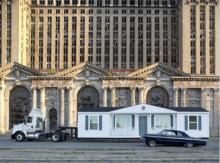 Mike Kelley's Mobile Homestead in front of the abandoned Detroit Central Train Station.
