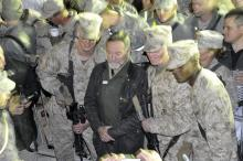 Robin Williams with U.S. Marines at a USO show in Afghanistan, December, 2010. Williams embraced the CMC ethos of service by giving his time, energy and talents to the troops.