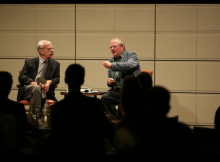 Adam Michnik discusses the political climate in Eastern Europe with a large Athenaeum group