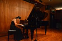 Sheena Hui plays the piano.