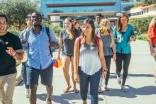 A group of CMC students walk from the Kravis Center.