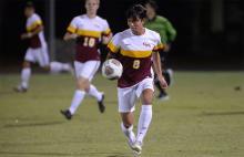 CMS men's soccer player Yusuke Kobayashi with the ball
