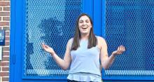 Haley Goodman '17 in front Roxbury Preparatory Charter School in Boston.