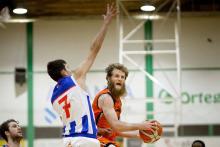 Michael Scarlett drives to basket