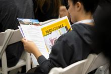 Student reviews a CMC welcome packet.