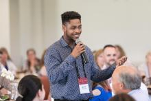 Quincy Brown '19 at an ImpactCMC event
