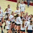 CMS volleyball team celebrates a victory