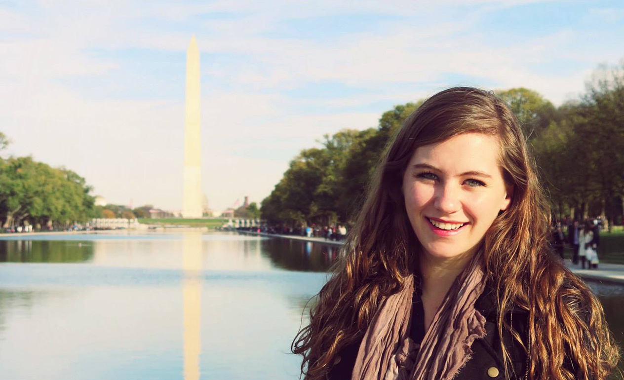 Student in front of the Washington Monument
